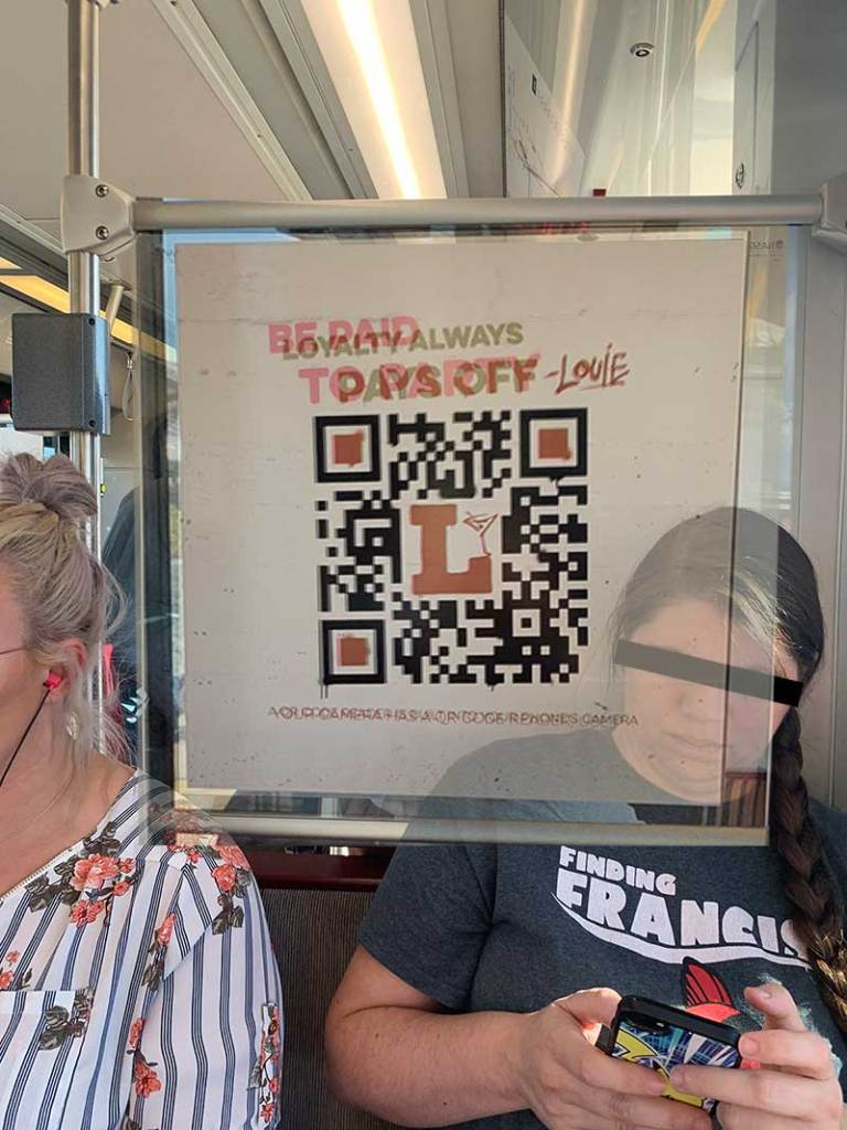 Overlayed Bar Louie light rail ads to show that the QR codes are identical.
