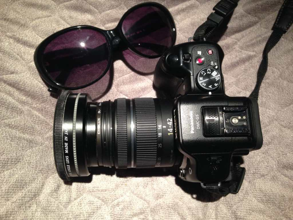 What to pack when traveling Sunglasses and camera