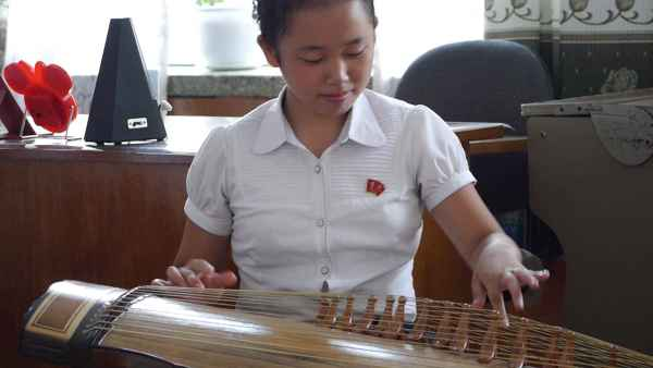 Children plays traditional instrument