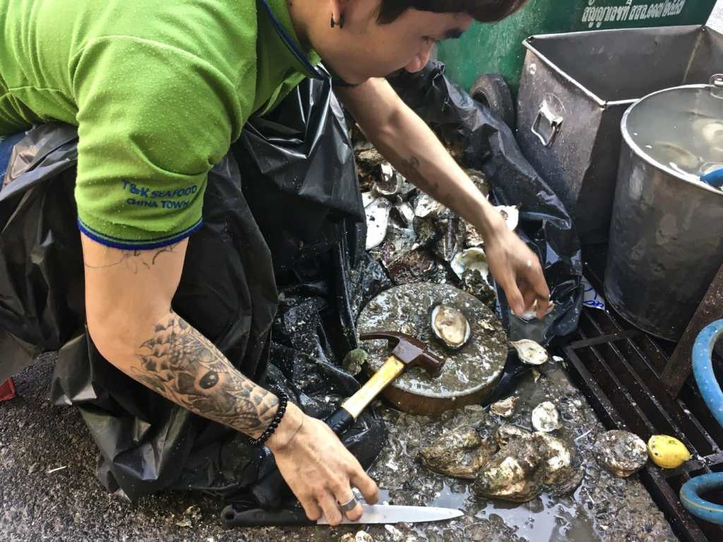 Shucking oysters in Bangkok Chinatown