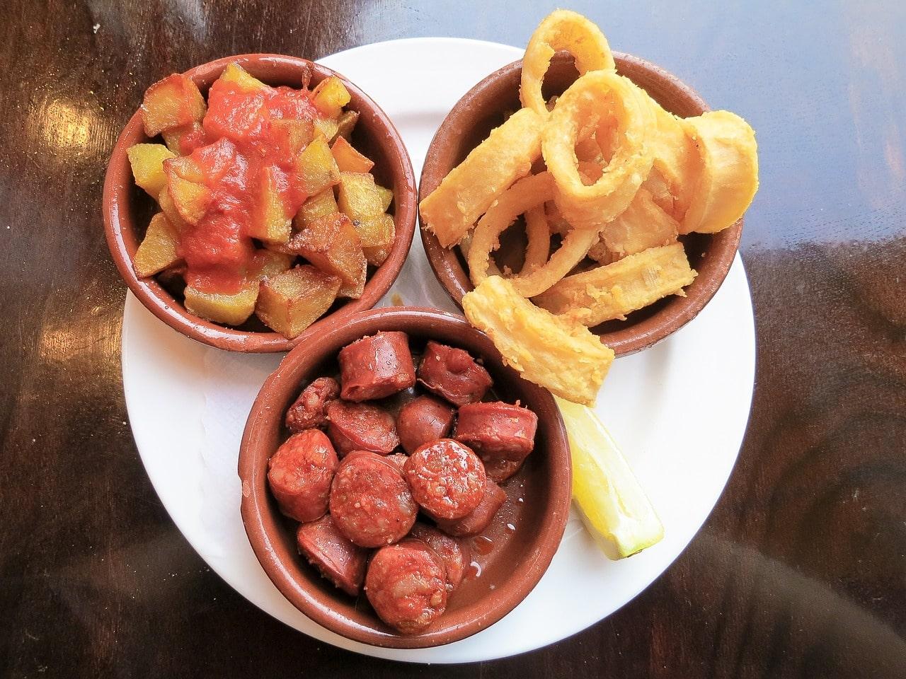 """""""Tapas: chorizo, calamari and patatas bravas"""""""