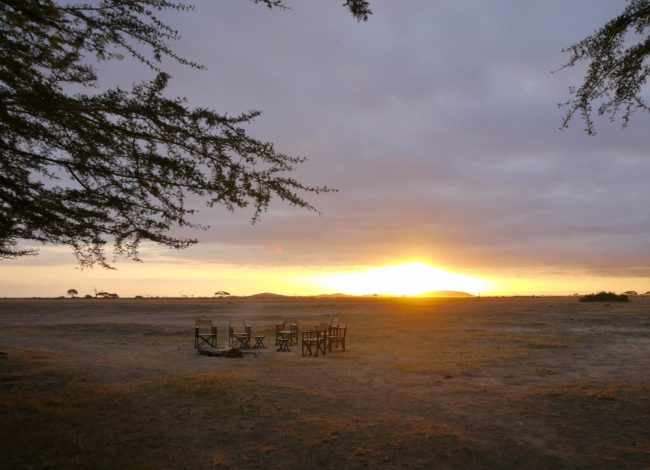 """Around the camp fire on safari"" typical day on safari"