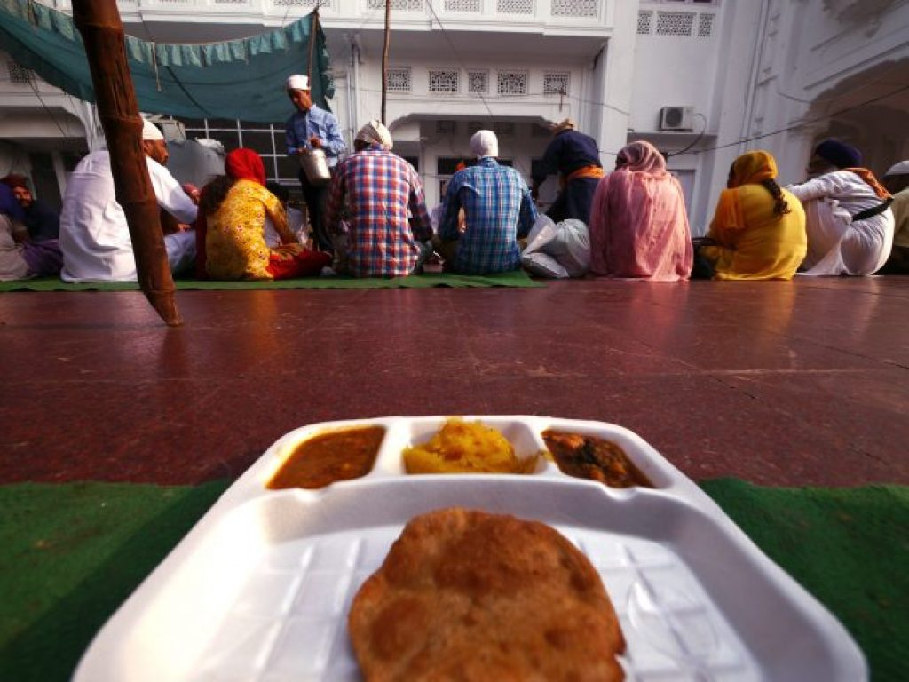 Enjoying langar at The Golden Temple