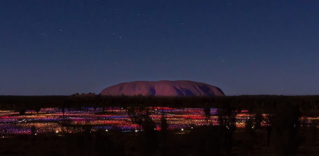 Field of Light against Uluru Ayers Rock