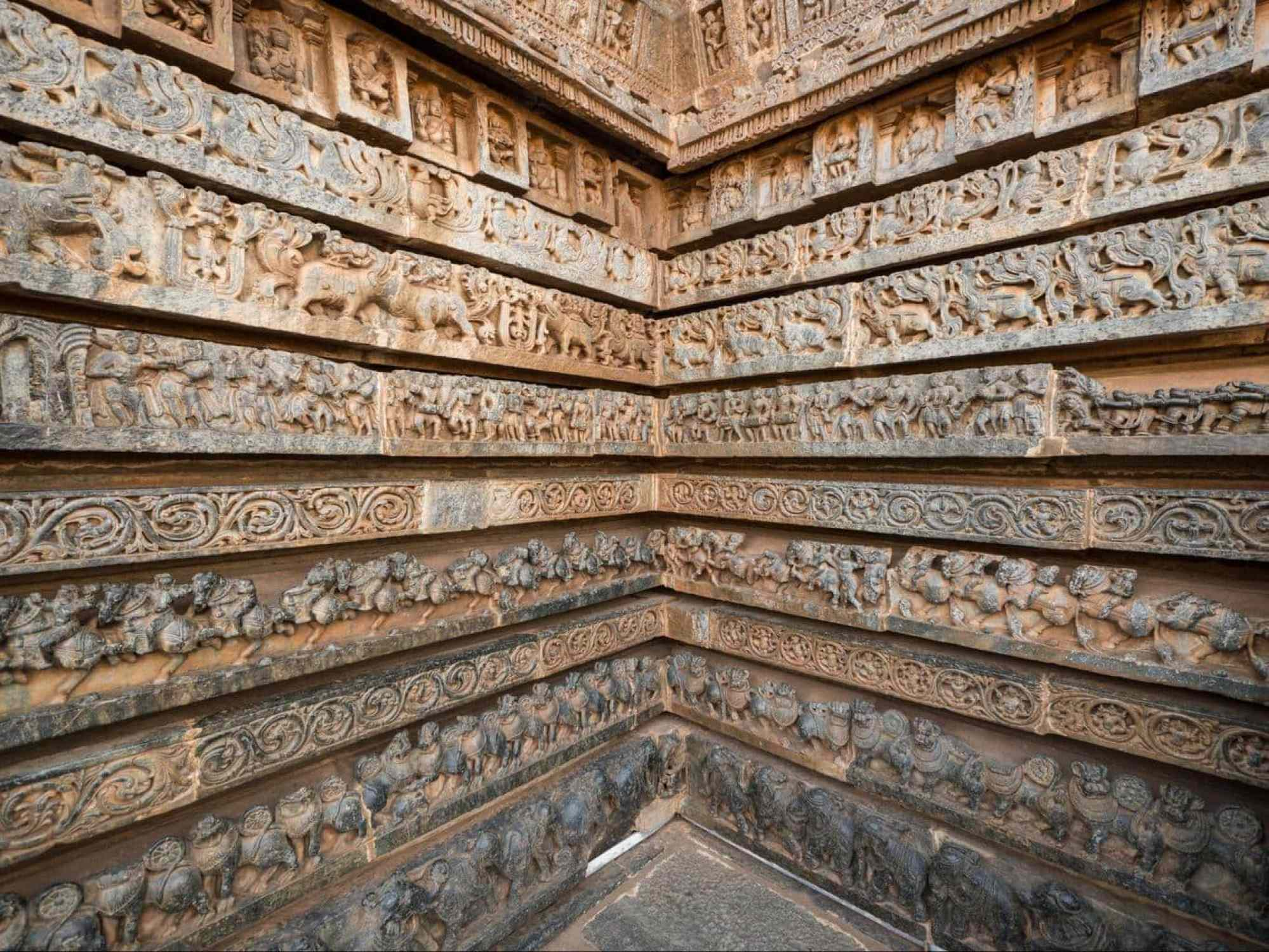 Halebidu outer walls covered with intricate carvings