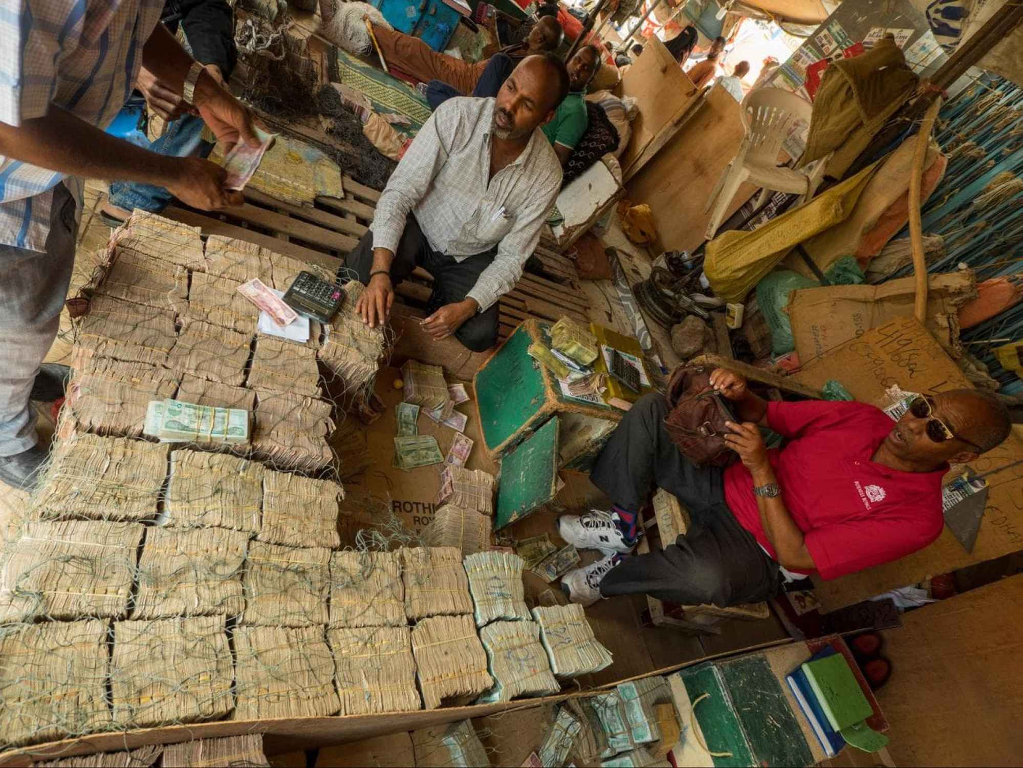 Piles of Somali Shilling at the stall of a money changer in Hargeisa