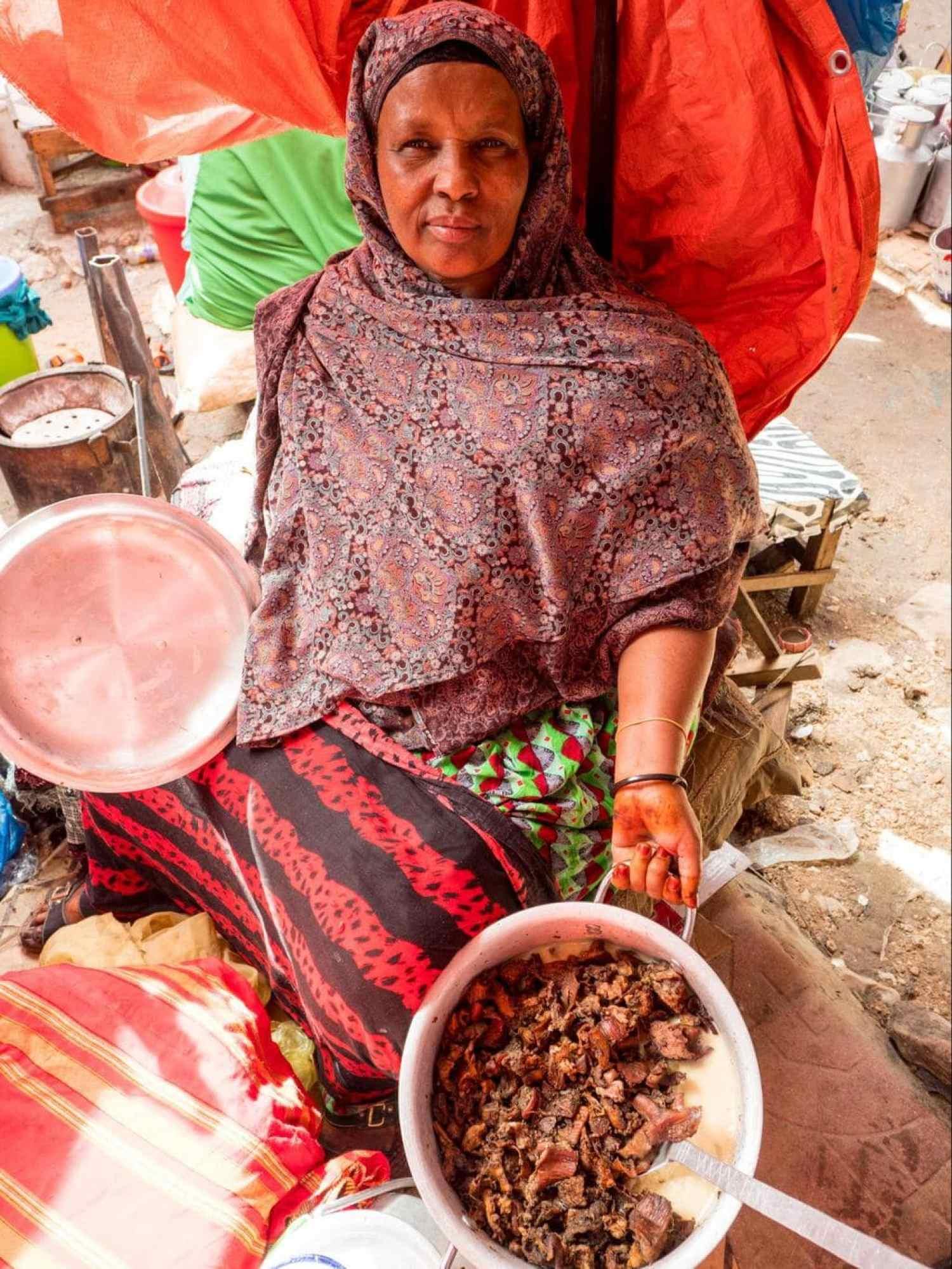 Somalilander market seller with her camel liver