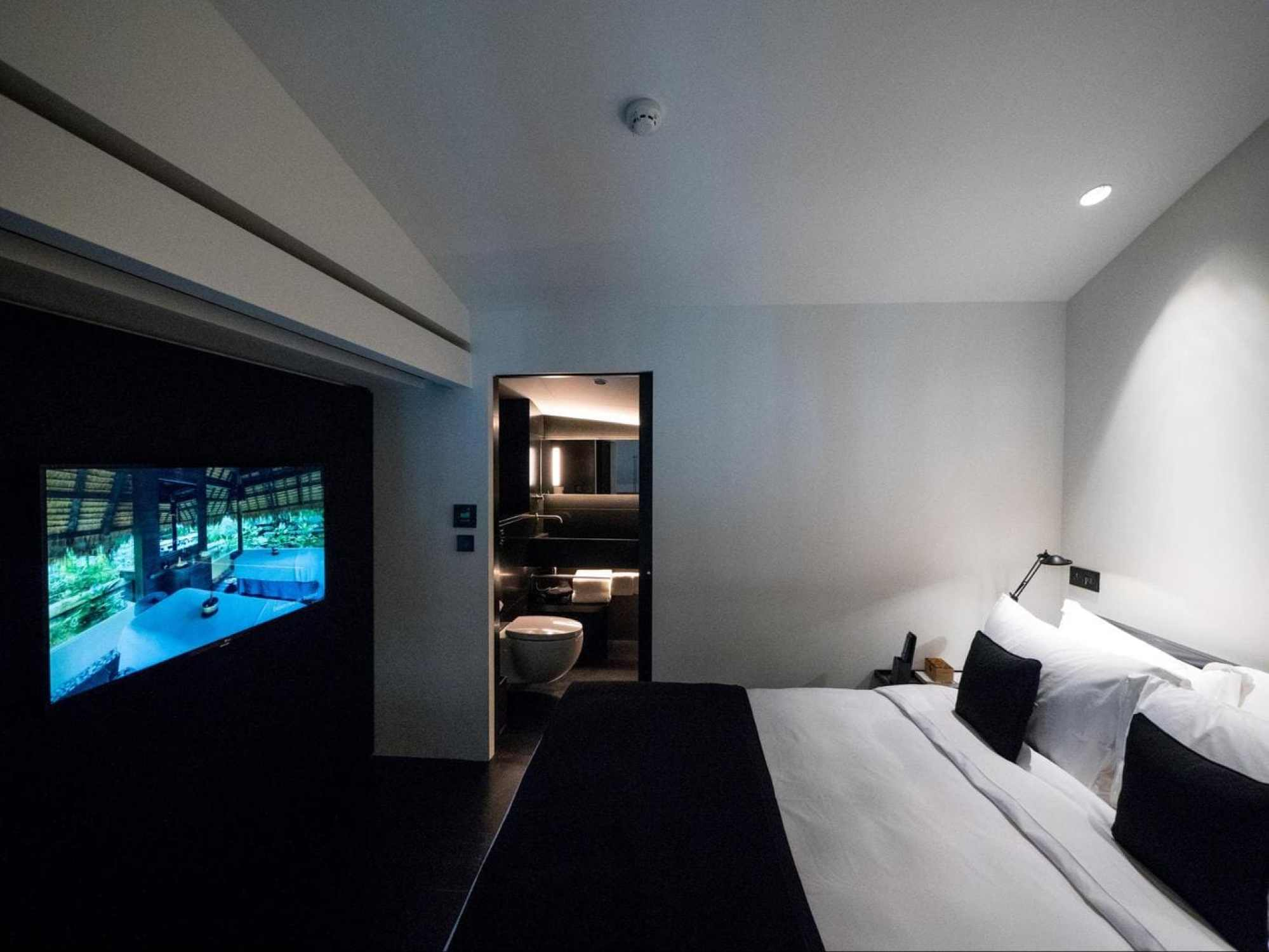 The bedroom upstairs at Six Senses Duxton Duplex Suite