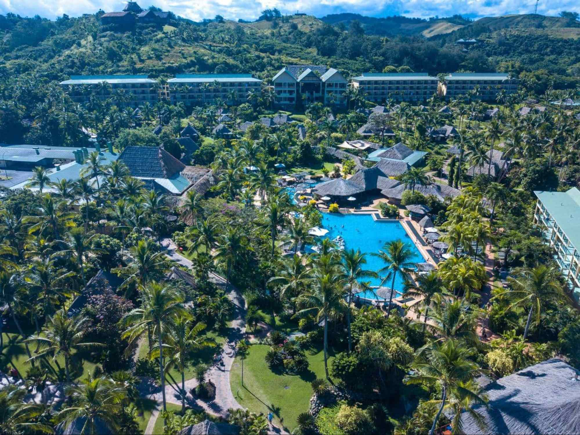 The main building and pool at Outrigger Fiji Beach Resort