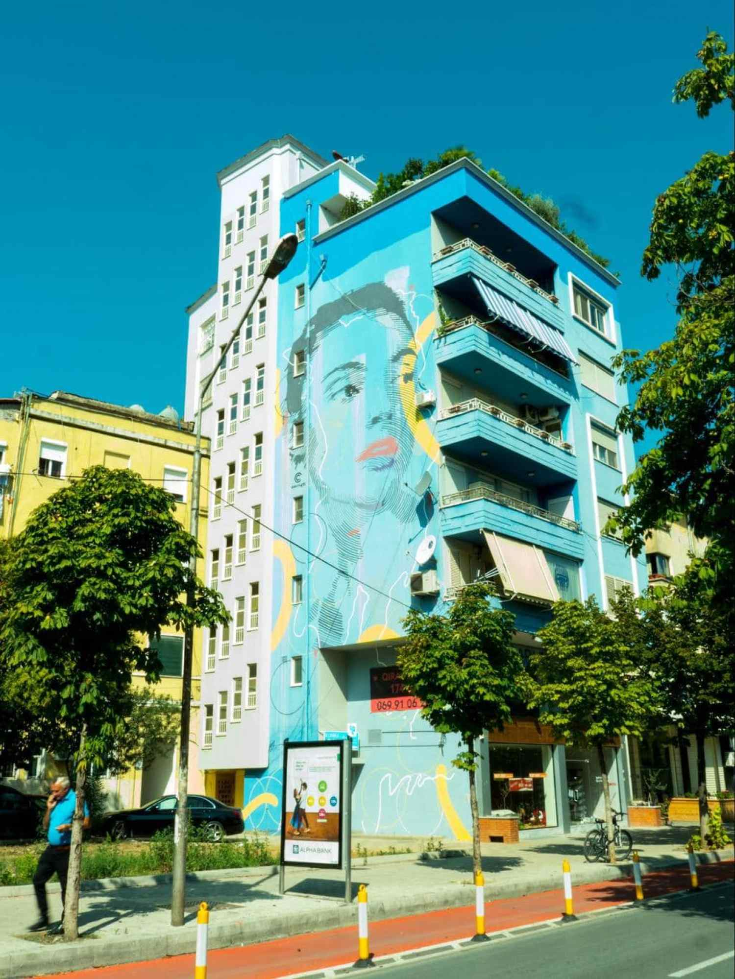 Blue portrait wall mural in Blloku