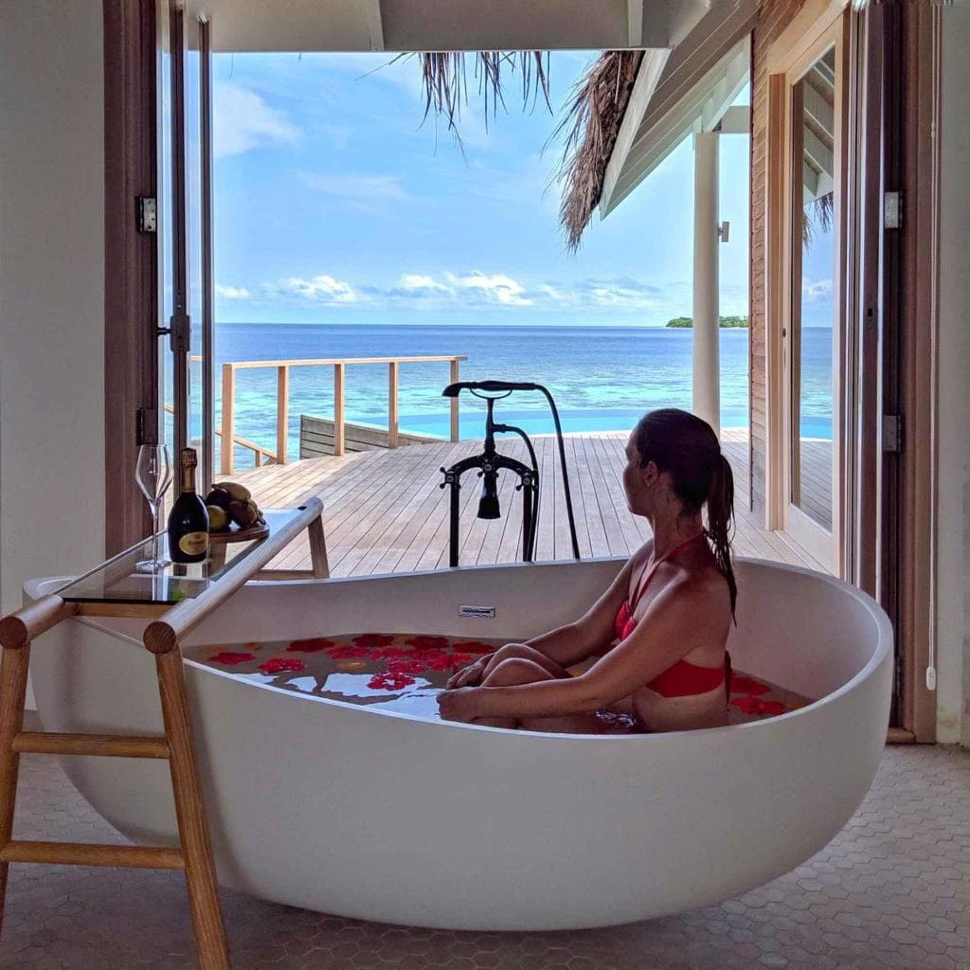 Bathtub views from the water villa at Milaidhoo