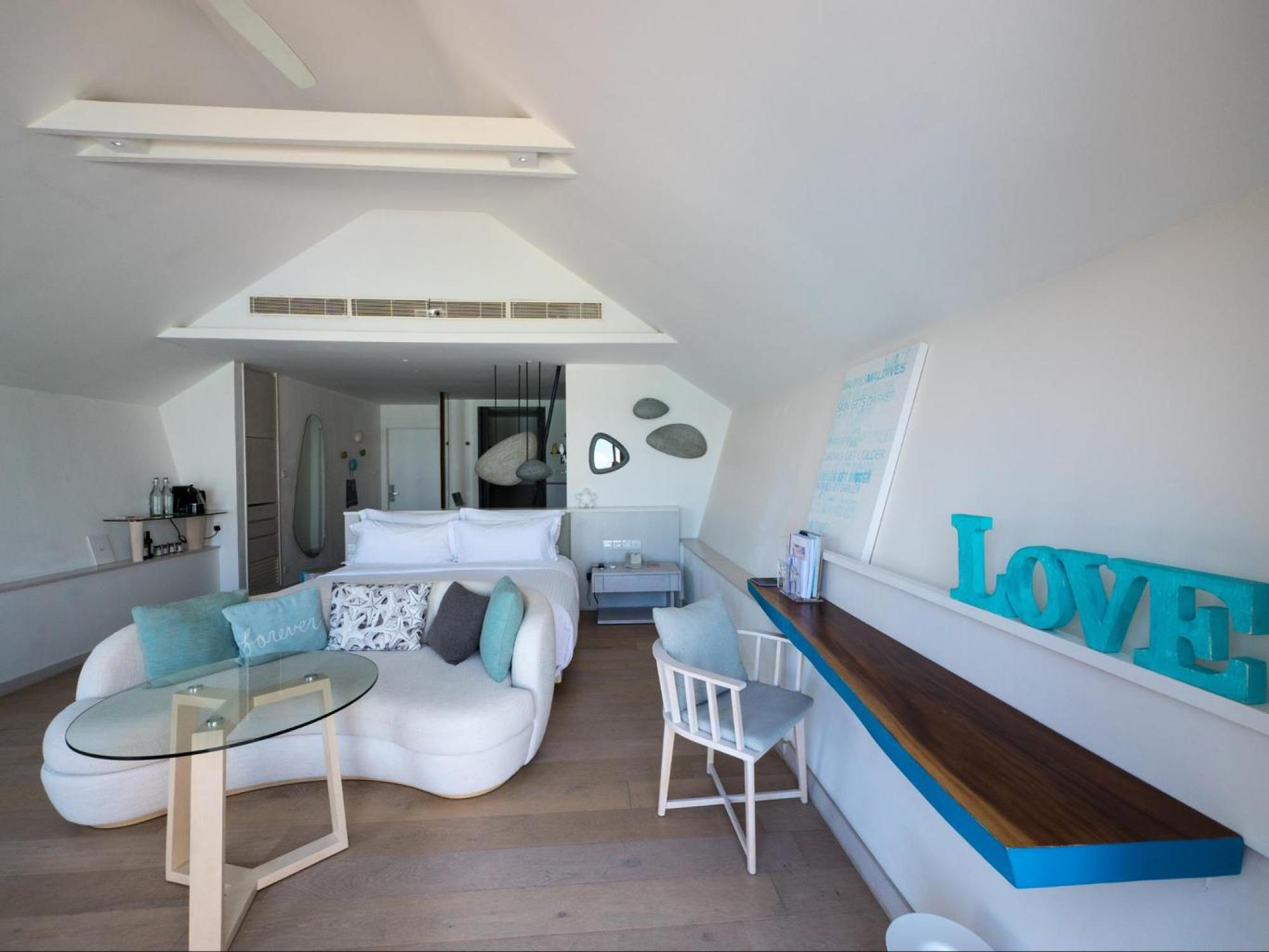 The bedroom in the romantic pool water villa at LUX*