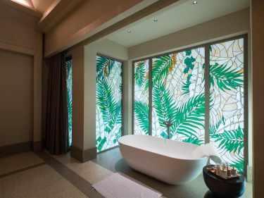 The four bedroom beach villa bathroom at Joali Maldives