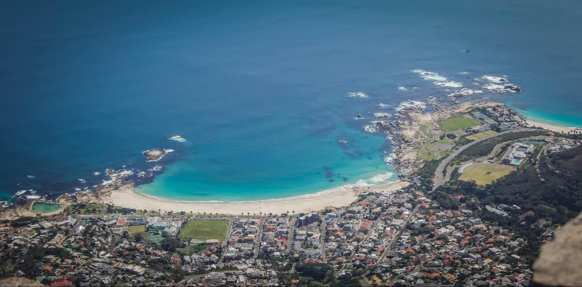 Camps Bay beach from above, with Clifton 4 in the right corner