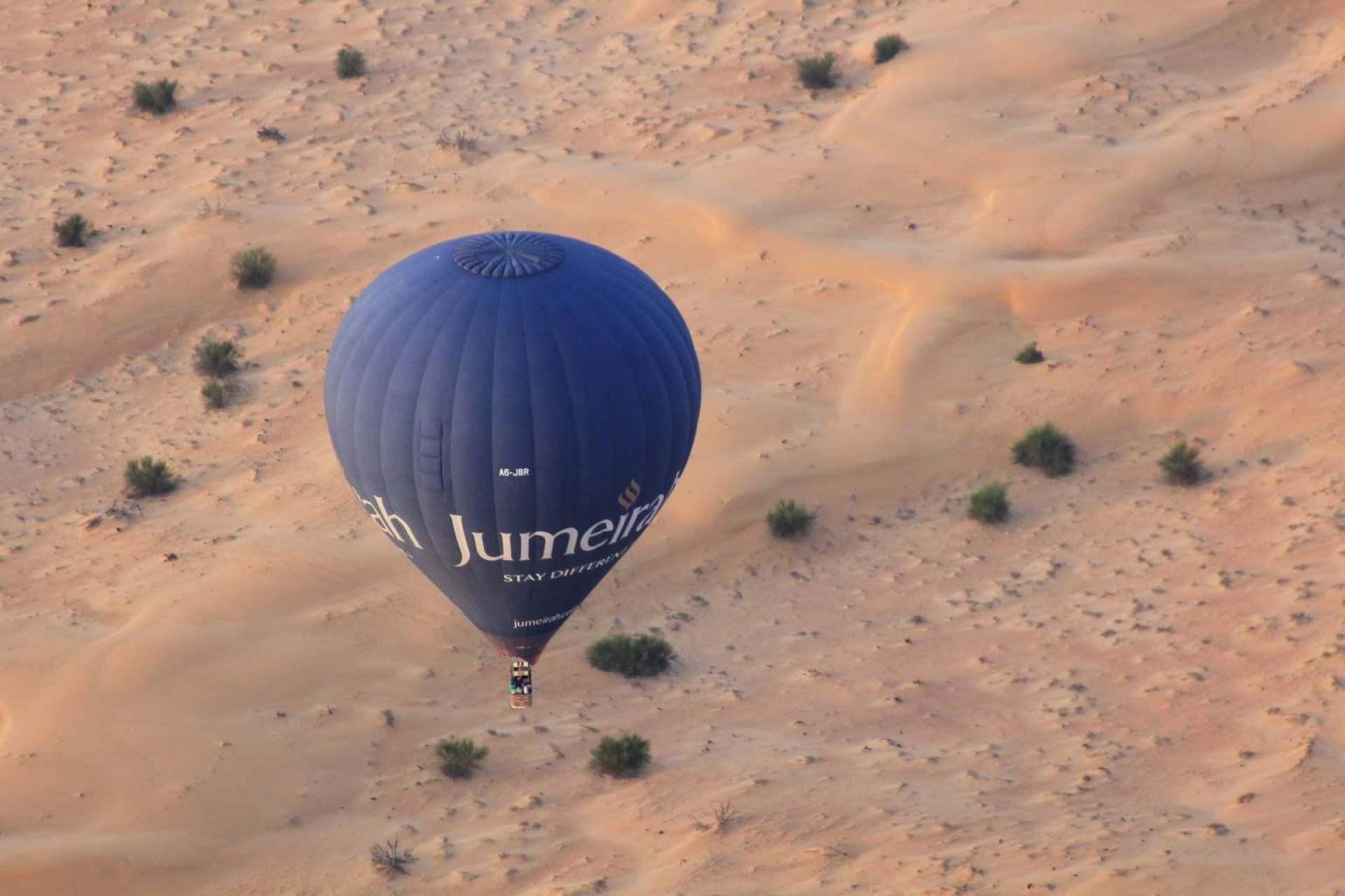 Sunrise hot air balloon over the desert