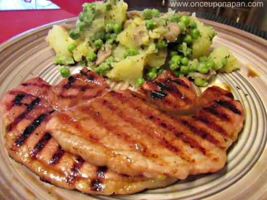 Grilled Gammon steak with potato, mushrooms and peas