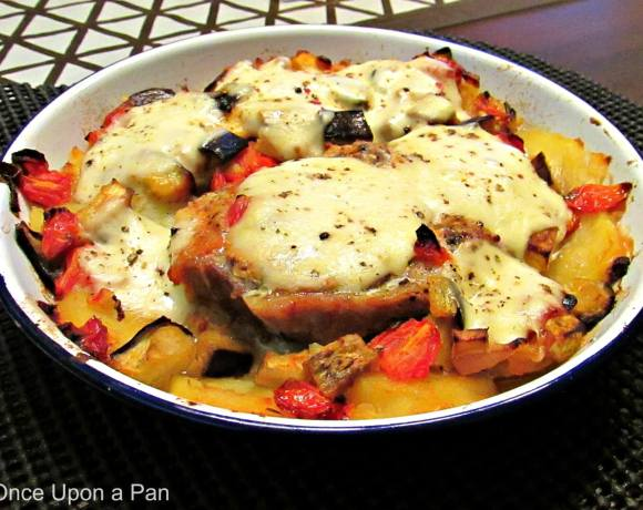 Roasted pork chops with aubergines, potatoes and mozzarella‏