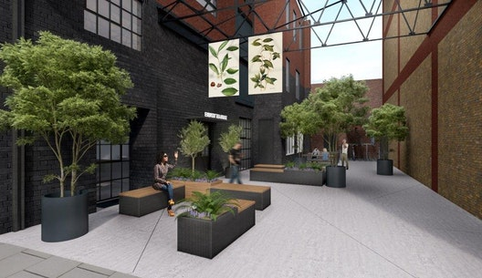 courtyard with block benches, plants and trees outside refurbished warehouse in Southwark