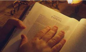 Hand in Bible