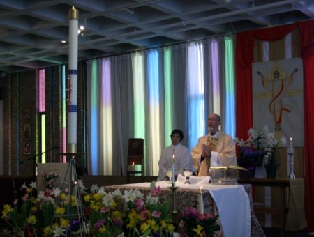 The late Father Paul Brouillette presides at Easter Sunday 2011
