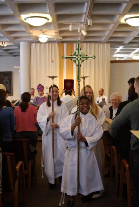 "Parishioner Wilma ""Billie"" Matkov smiles into the future to the right of the procession party."