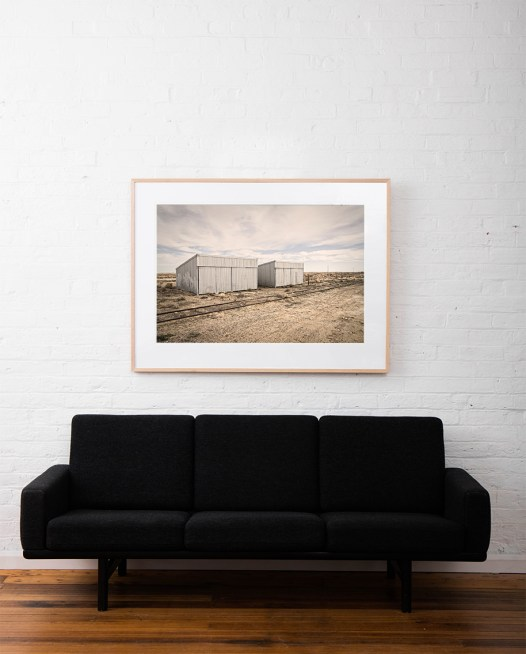 Australia Landscape photo framed in raw timber on white wall above sofa