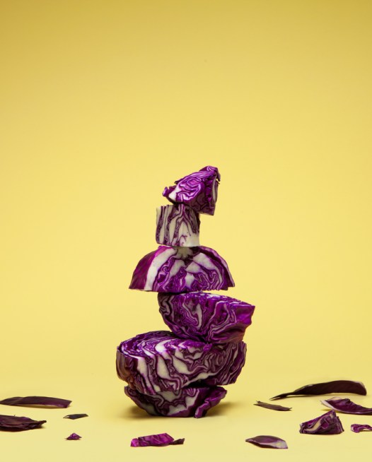 Still Life photo of purple cabbages with yellow background