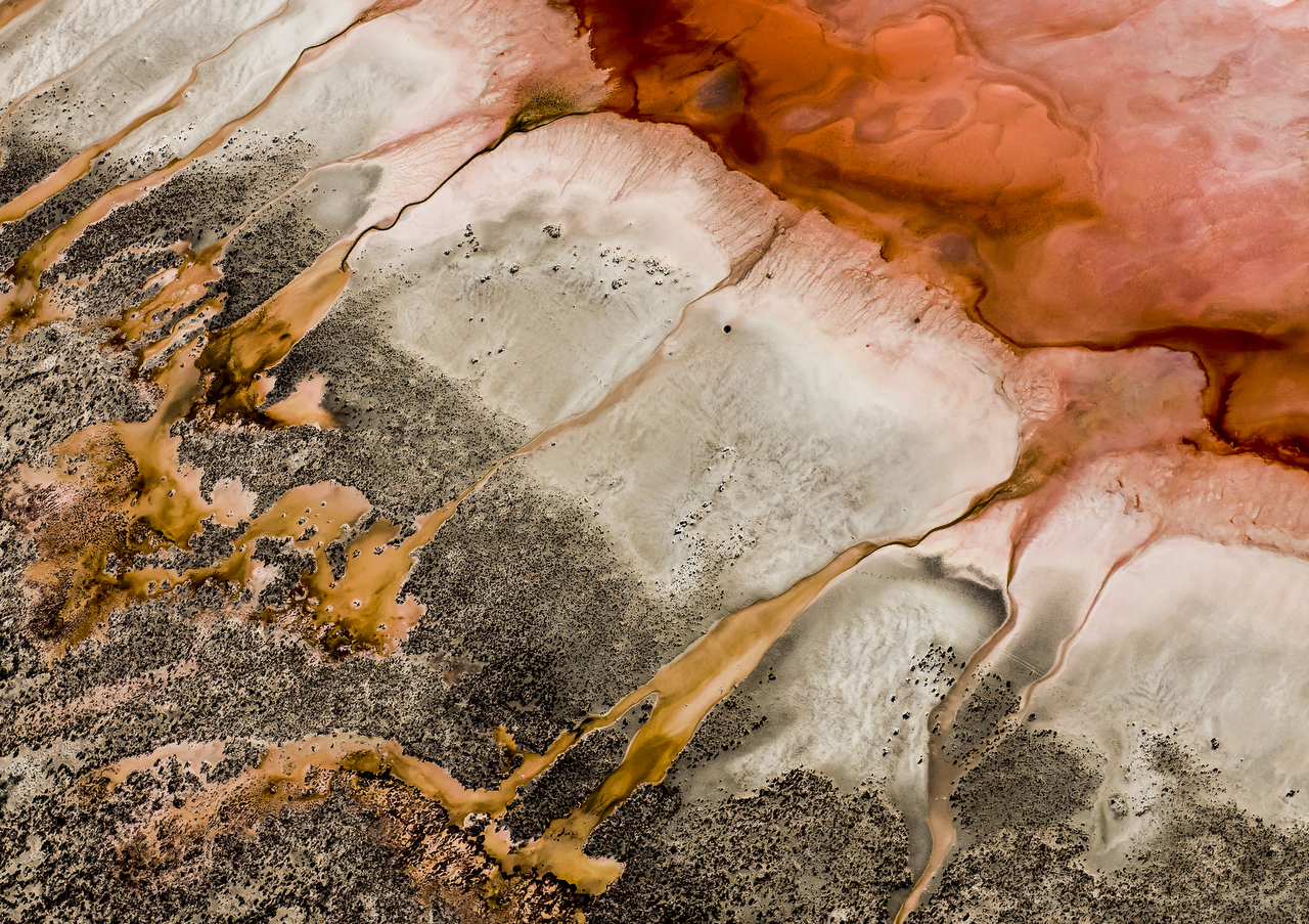 Red and brown aerial photo of the Western Australian landscape by Photographer Paul Hoelen