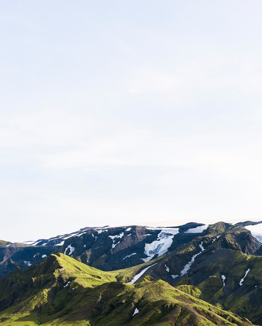 Icelandic Landscape photo in green and blue of glaciers, mountain, snow and blue sky
