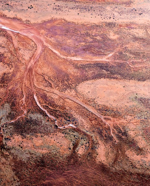 Red and pink aerial photo of the Western Australian landscape.