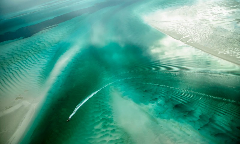 An Abstract Aerial Landscape photograph of water in green and white