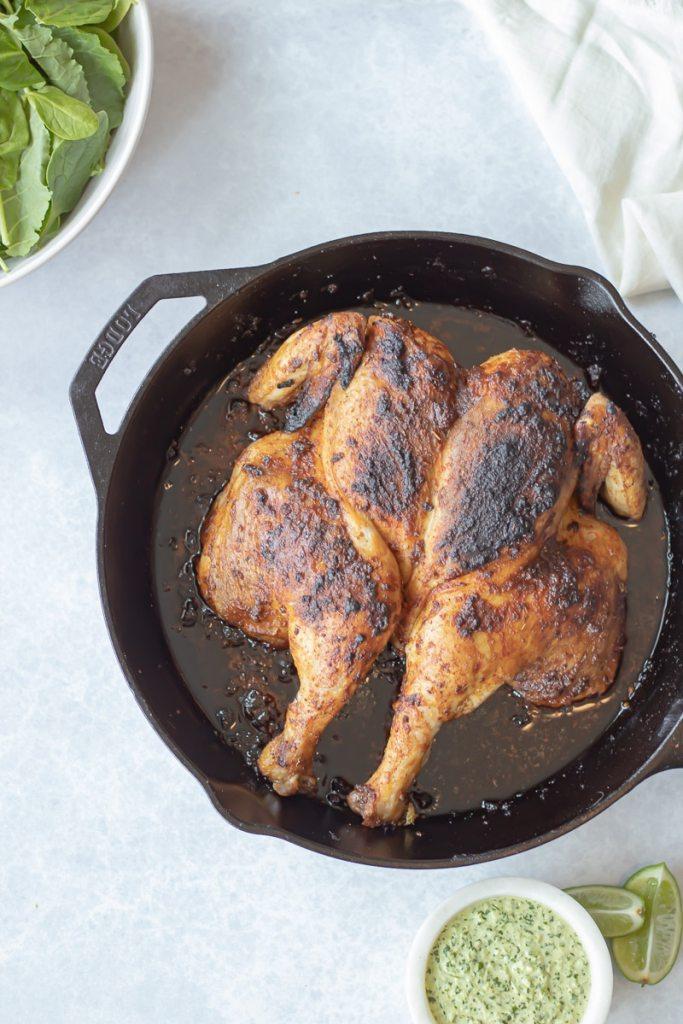 spiced roast chicken in cast iron pan
