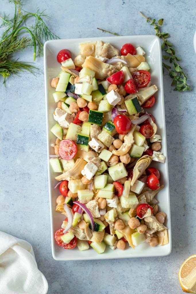 greek salad with marinated feta on platter