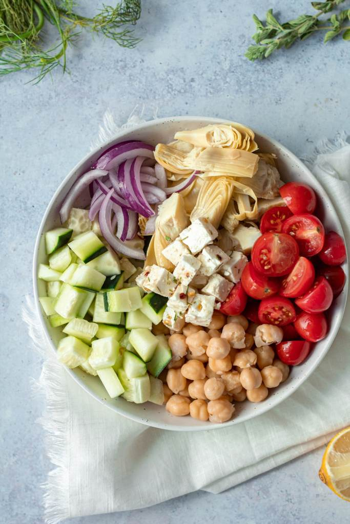 ingredients for marinated greek salad in small plate