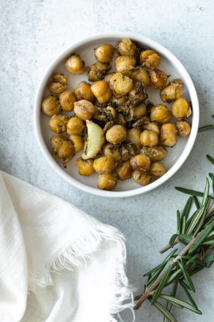 crispy chickpeas with garlic and rosemary on small plate