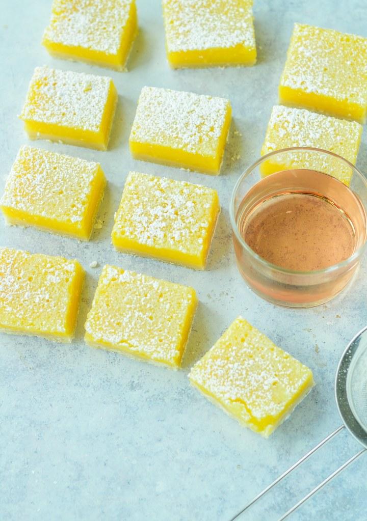 cut lemon rosé bars with small glass of rosé wine