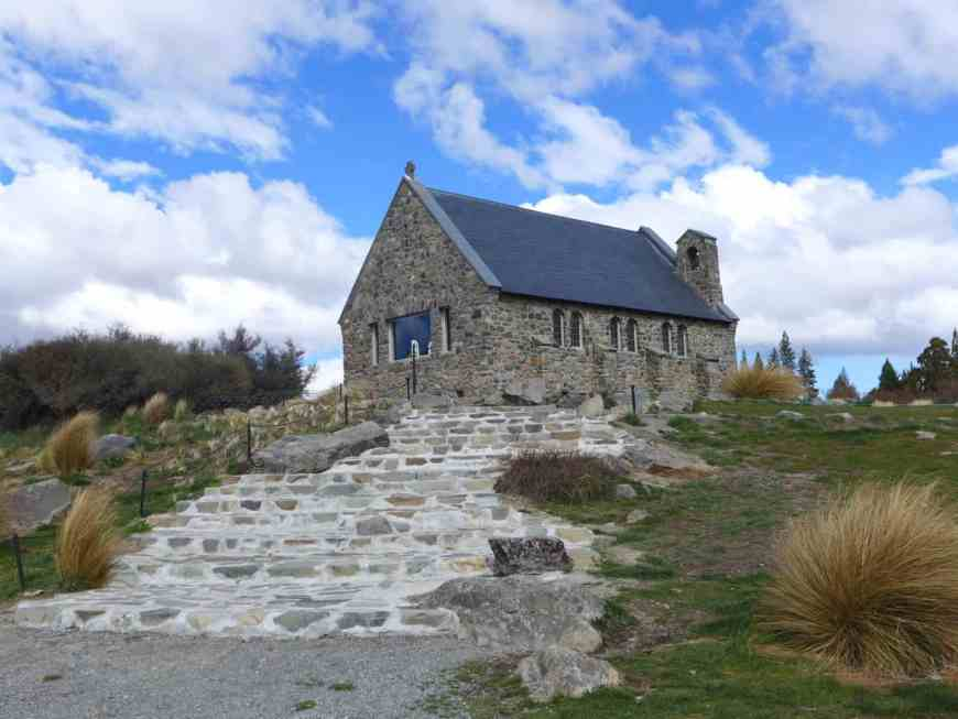 The iconic Church of the Good Shepherd in Lake Tekapo, NZ. One of the best-known New Zealand landmarks, sitting in front of the aquamarine lake and snow-capped mountains. Inspiration for your visit!