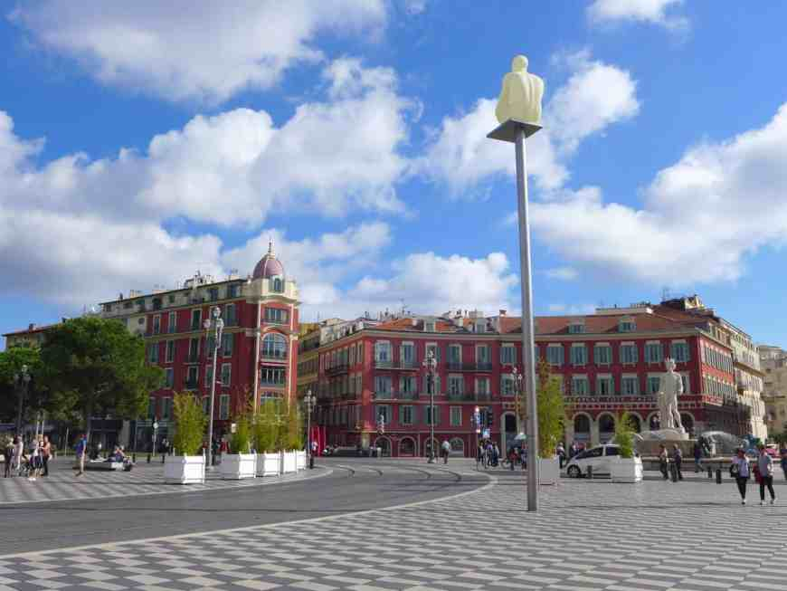 Nice's Place Massena is full of colorful buildings and interesting statues, and a statue with a super fun and scandalous backstory