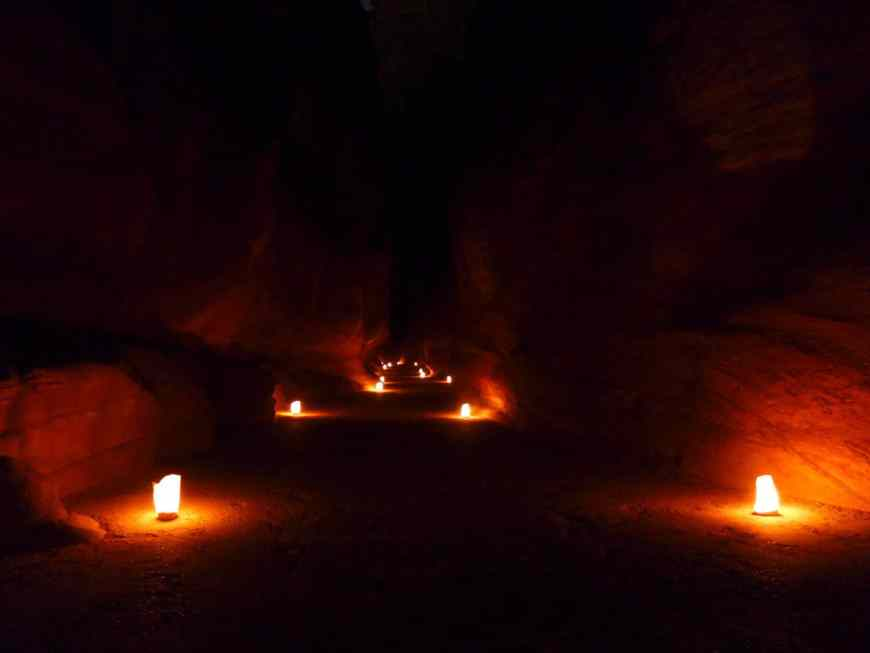 Mesmerizing Petra by Night is a can't-miss experience when visiting Jordan | Siq lit up by lanterns | Tips for seeing Petra at Night, one of the Seven Wonders of the World | Lost City of Petra at night, Wadi Musa, Jordan #jordan