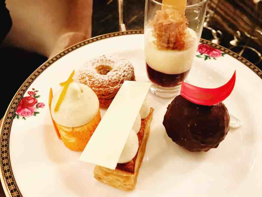What to expect from an afternoon tea at The Langham in London. With amazing service, a beautiful setting, and delicious little sandwiches to scones, pastries, & champagne, you'll be happy you splurged on this special experience! #london #afternoontea #traveltips