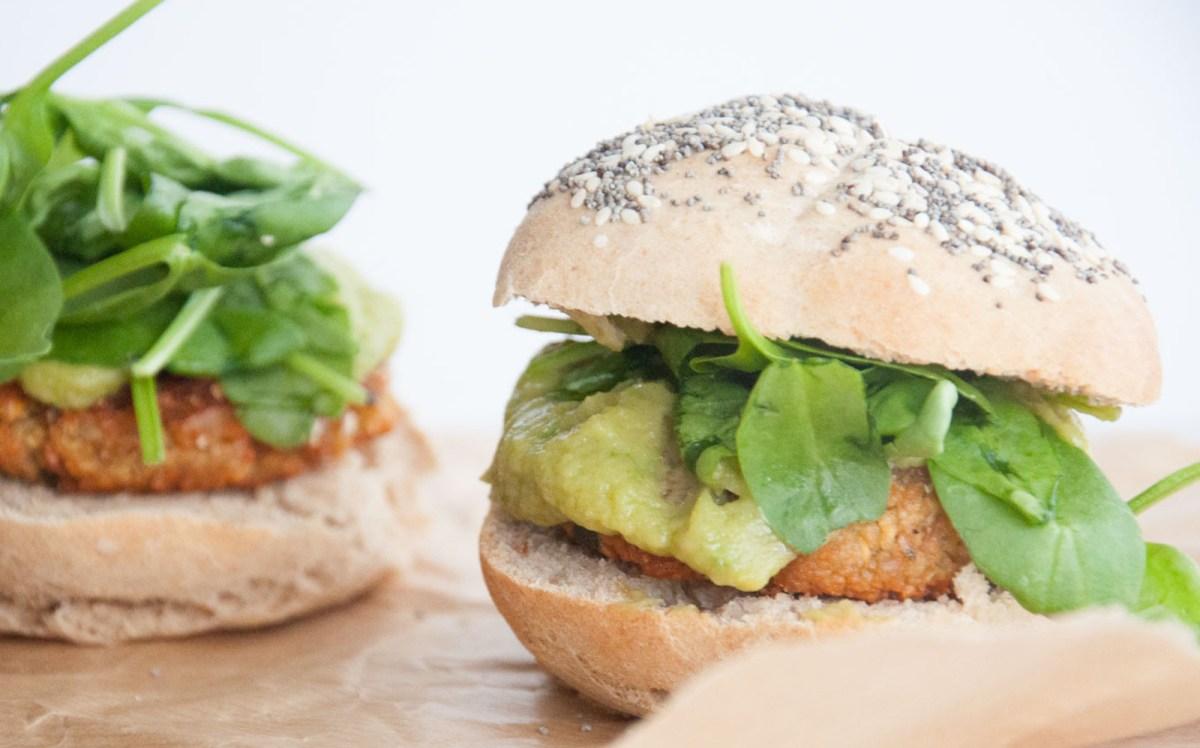 Falafel Burger With Avocado Sauce, Spinach, and Homemade Burger Buns [Vegan]