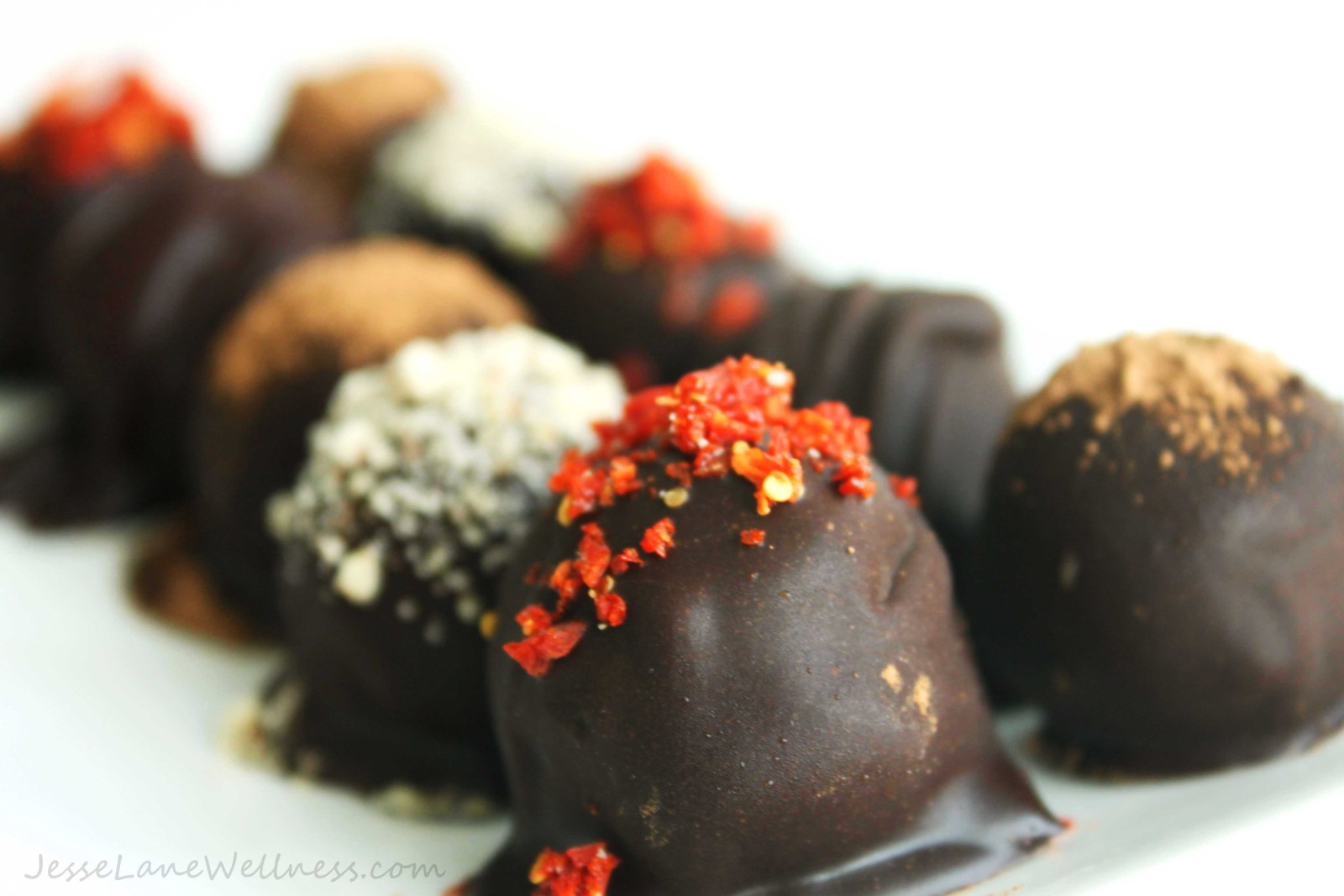 Vegan Chocolate Coated Hazelnut Truffles with various toppings