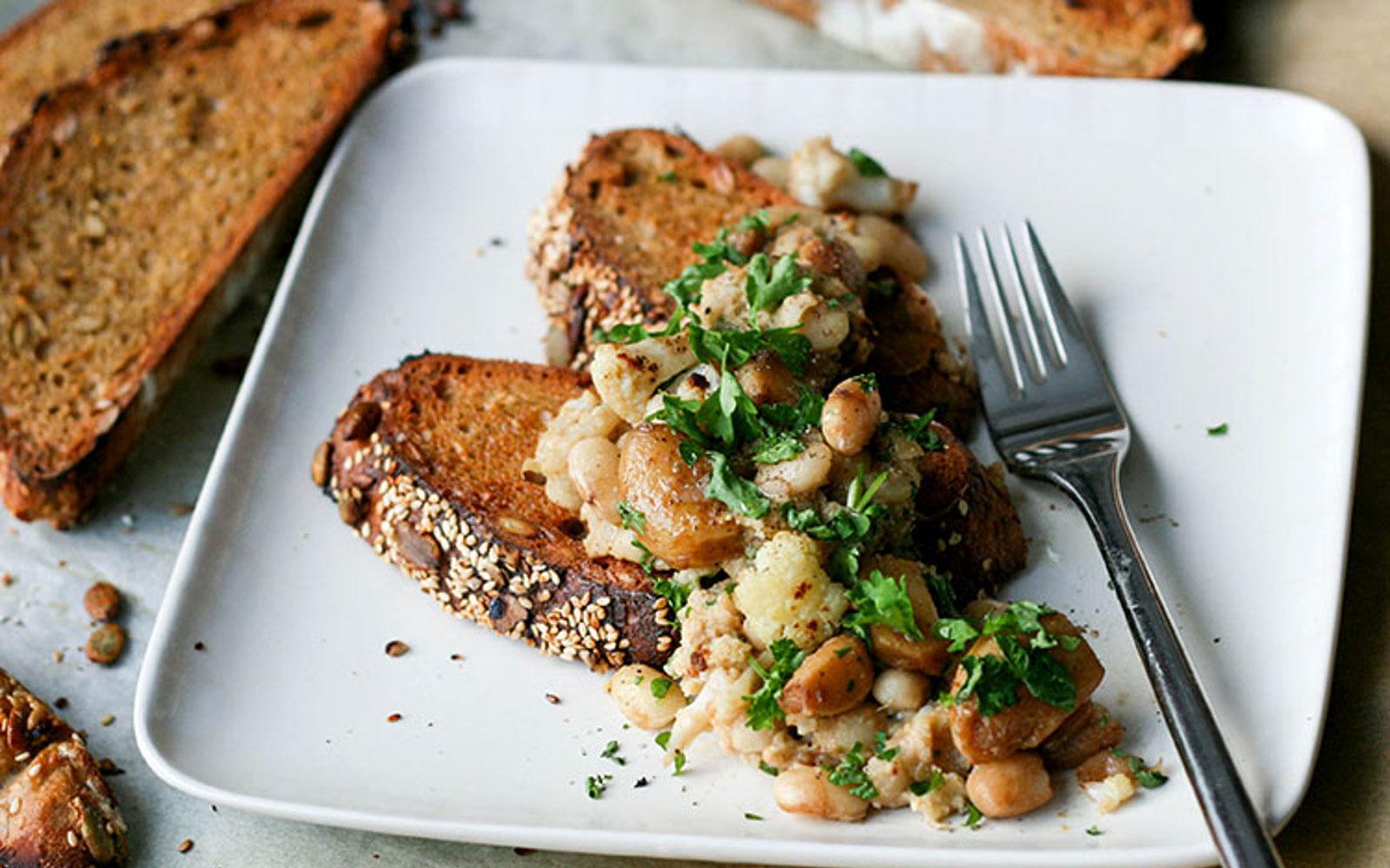 White Bean, Cauliflower, and Caramelized Garlic Toasts