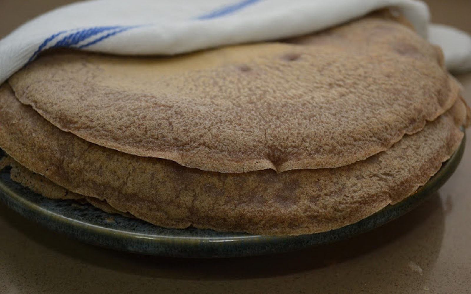 Injera: Ethiopian Sourdough Flatbread With Spiced Stew