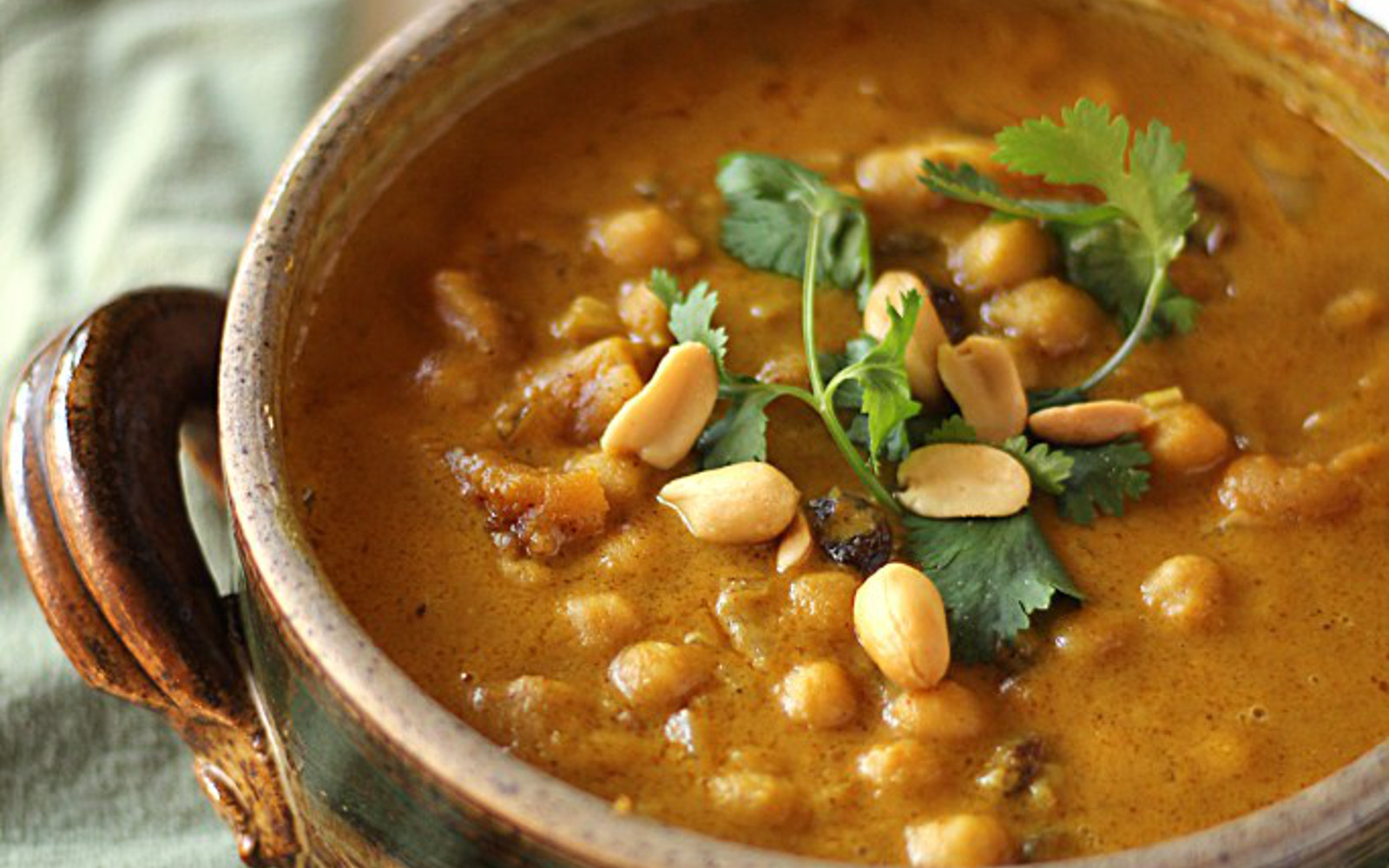 Vegan Chickpea Peanut Stew With Apricot and Raisins [Gluten-Free] topped with cilantro