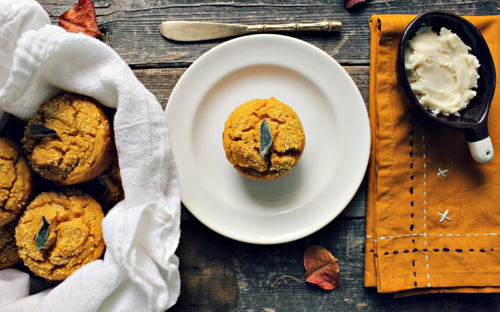 Vegan gluten-free Sweet Potato and Sage Corn Muffins topped with sage