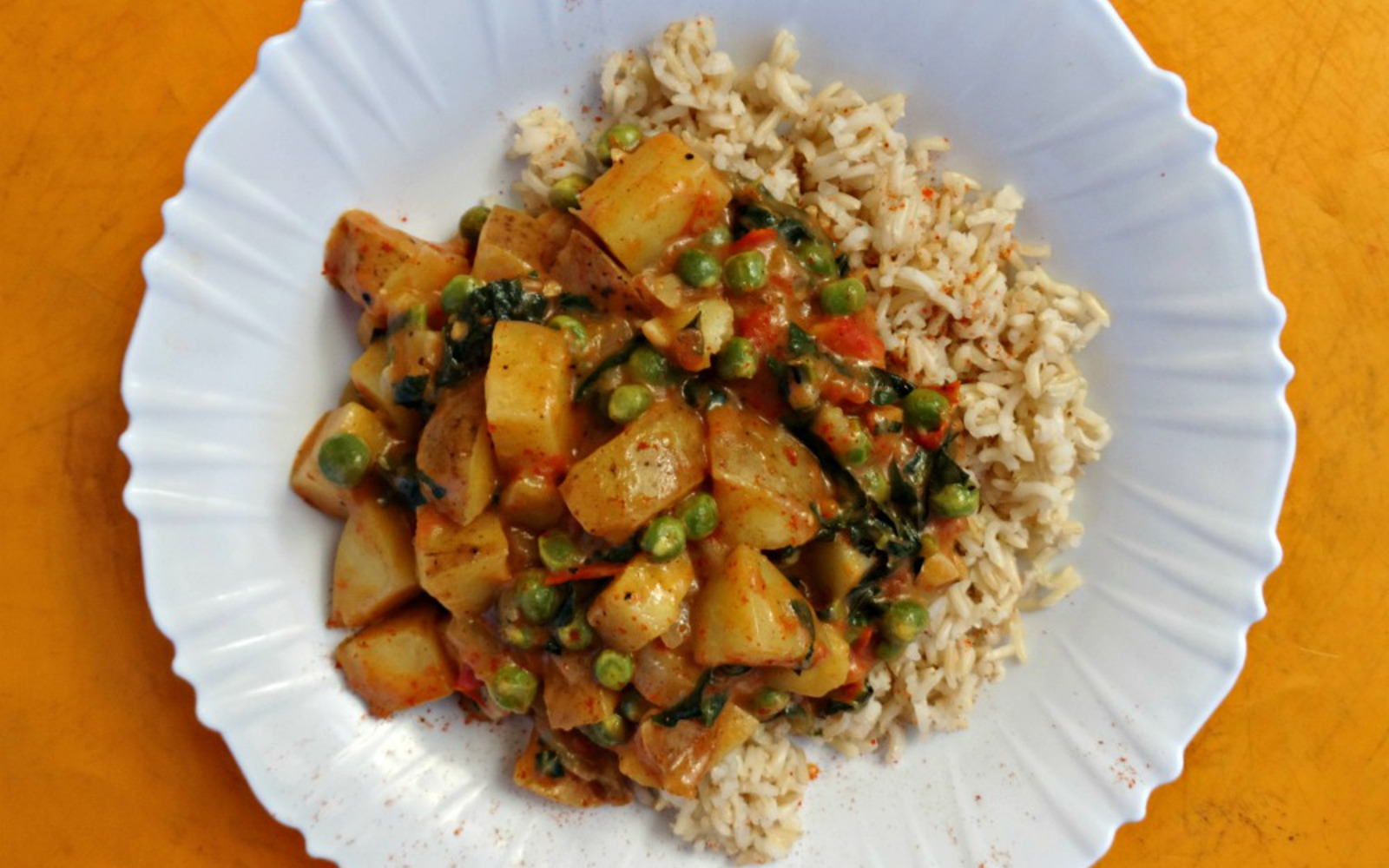 Vegan Nourishing Potato Curry With Kale, peas, and a side of rice