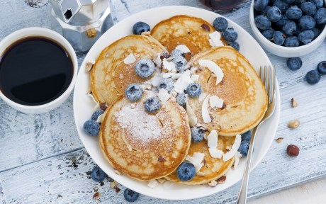 blueberry pancakes with coconut flakes and sugar