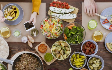 People at table eating vegan meal