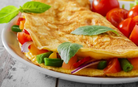 Vegan omelet with vegetables and side of tomatoes